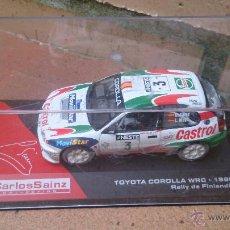 Coches a escala: COCHE COLECCIÓN NUESTROS CAMPEONES DE RALLYES, TOYOTA COROLLA WRC, CARLOS SAINZ. Lote 48676665