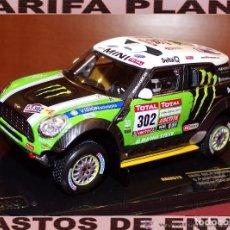Coches a escala: MINI ALL 4 RACING WINNER RALLYE RAID DAKAR 2012 PETERHANSEL ESCALA 1:43 DE IXO EN SU CAJA. Lote 62401684
