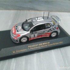 Coches a escala: PEUGEOT 206 WRC #1 M.GRONHOLM - T.RAUTIAINEN WINNER GREAT BRITAIN 2001 - IXO MODELS - 1/43. Lote 71721823