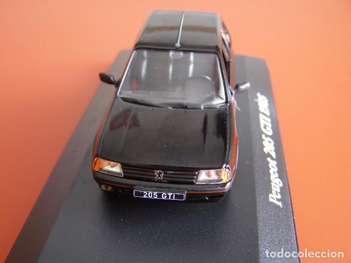 Coches a escala: PEUGEOT 205 GTI DE 1985, EDICIONES ATLAS , COLECCIÓN SUIZA, ESCALA 1/43 - Foto 2 - 89537048