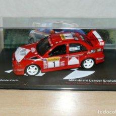 Auto in scala: COCHE MITSUBISHI LANCER EVOLUTION VI MAKINEN RALLY MONTECARLO 1999 IXO CAR 1/43. Lote 226687220