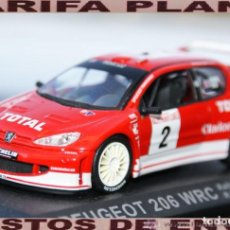Coches a escala: PEUGEOT 206 WRC RALLYE DE MONTE CARLO 2003 R.BURNS - R.REID ESCALA 1:43 DE ALTAYA EN CAJA. Lote 295911748