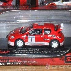 Coches a escala: UD00001PEUGEOT 206 WRC TOTAL GRONHOLM (N.ZELANDA) 2003ESCALA 1/72. Lote 26094914