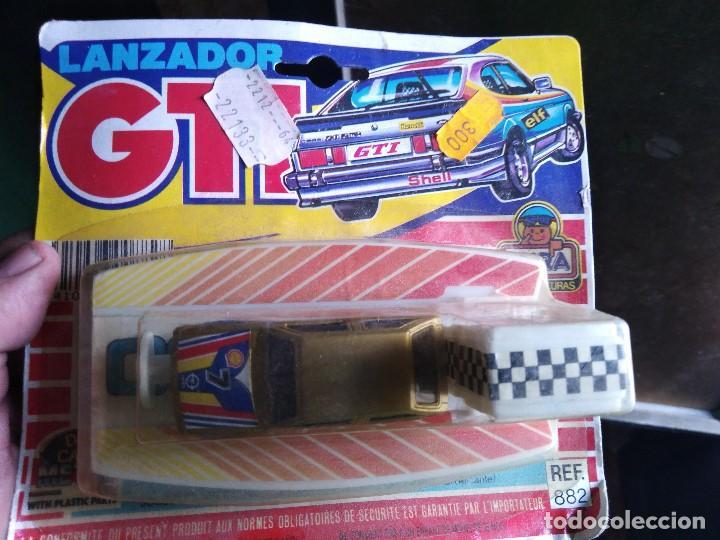 Coches a escala: lanzador coche GTI de mira en blister coche opel corsa blister muy raros .años 80 - Foto 2 - 208190606
