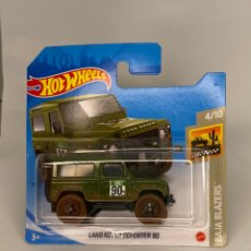 Coches a escala: HOTWHEELS LAND ROVER DEFENDER 1990. Lote 231037630