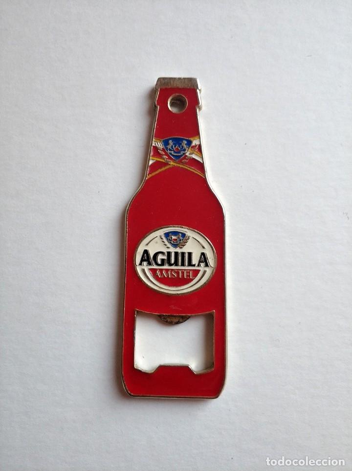 BONITO ABRIDOR CERVEZA EL AGUILA AMSTEL FORMA BOTELLA - METALICO LACADO CERVEZAS ABREBOTELLAS (Coleccionismo - Botellas y Bebidas - Abrebotellas y Sacacorchos)