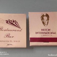 Cajas de Cerillas: RETRO 2 ANTIGUAS CARTERITAS CERILLAS HOTEL HILTON ABIDJAN. Lote 260378800
