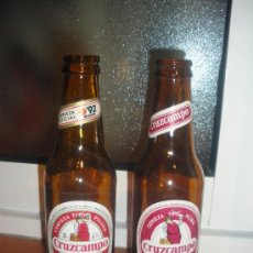 Coleccionismo de cervezas: 2 BOTELLINES DE CERVEZA CRUZCAMPO. AÑOS 80 Y EXPO 92. QUINTOS, ETIQUETA.. Lote 19911597