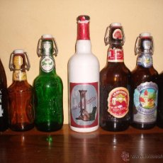 Coleccionismo de cervezas: LOTE 7 BOTELLAS CERVEZA - TAPON CERAMICA - 1 BOTELLA SERIGRAFIADA, 4 EN RELIEVE, 1 LLENA. Lote 50255362