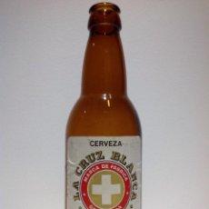 Coleccionismo de cervezas: ANTIGUA BOTELLA DE CERVEZA * LA CRUZ BLANCA * ETIQUETA DE PAPEL 33 CL TERCIO. Lote 50478950