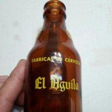 Coleccionismo de cervezas: BOTELLA ANTIGUA DE CERVEZA EL AGUILA SERIGRAFÍA EN AMARILLO 20CL. Lote 180117386