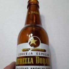 Coleccionismo de cervezas: BOTELLA ANTIGUA CERVEZA ESTRELLA DORADA DAMM CON FALLO EN SERIGRAFÍA. Lote 105801912