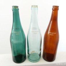Coleccionismo de cervezas: LOTE DE 3 BOTELLAS ANTIGUAS CERVEZA ESTRELLA DE GIJON MARRÓN TRANSPARENTE Y VERDE DE 66 CL . Lote 112487223