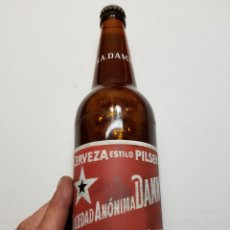 Coleccionismo de cervezas: BOTELLA ANTIGUA CERVEZA DAMM 75CL SIN ROSELLON LLENA. Lote 125850664