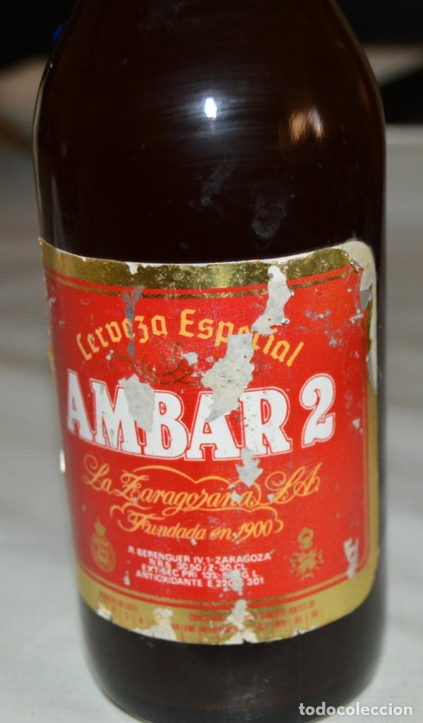 Coleccionismo de cervezas: BOTELLA - AMBAR 2 - COMPLETA - CON CHAPA - Foto 2 - 131654218