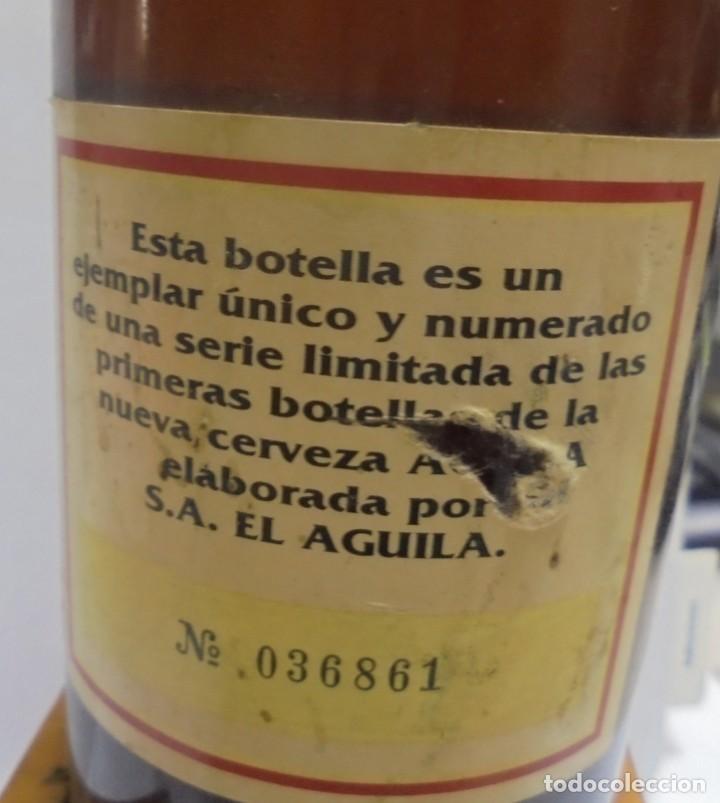 Coleccionismo de cervezas: CERVEZA. AGUILA. EJEMPLAR UNICO Y ENUMERADO. PRIMERAS BOTELLAS. Nº 036861. EN PIE DE MADERA. VER - Foto 9 - 150956666