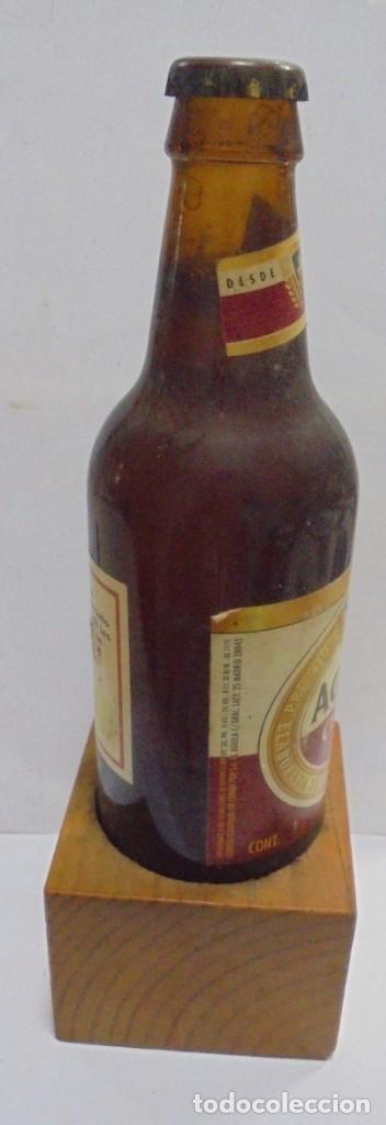 Coleccionismo de cervezas: CERVEZA. AGUILA. EJEMPLAR UNICO Y ENUMERADO. PRIMERAS BOTELLAS. Nº 036861. EN PIE DE MADERA. VER - Foto 10 - 150956666