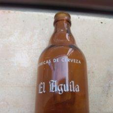 Coleccionismo de cervezas: BOTELLA DE CERVEZA EL AGUILA. Lote 146134346