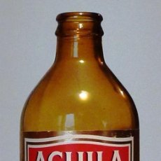 Coleccionismo de cervezas: BOTELLA CERVEZA ÁGUILA PILSENER 33 CL MODELO 1 - VACÍA. Lote 148914394