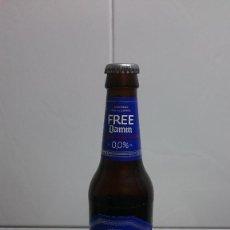 Coleccionismo de cervezas: BOTELLA CERVEZA FREE DAMM 0,0% CHAPA Y LIQUIDO ORIGINAL. Lote 155797126