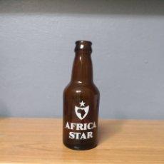 Coleccionismo de cervezas: BOTELLA CERVEZA ÁFRICA STAR. BOTELLIN SERIGRAFIADA DE LA EXTINGUIDA FÁBRICA DE CEUTA. QUINTO 20CL. Lote 168547833