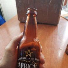 Coleccionismo de cervezas: RARISIMA BOTELLA CERVEZA AFRICA STAR LA ESTRELLA DE ÁFRICA CEUTA 28 CL MODELO 2. Lote 184108770