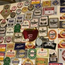 Coleccionismo de cervezas: COLECCIÓN 70 ETIQUETAS BOTELLAS CERVEZAS. AGUILA, ESTRELLA DEL SUR, CRUZCAMPO, HEINEKEN. Lote 189714910