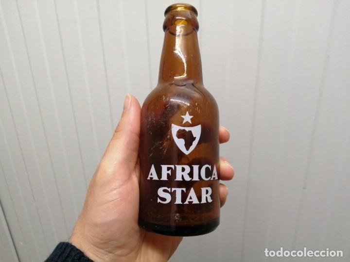 ANTIGUA BOTELLA LA ESTRELLA AFRICA CEUTA STAR SERIGRAFIADA DE 20 CL CERVEZA (Coleccionismo - Botellas y Bebidas - Cerveza )