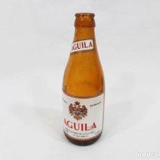 Coleccionismo de cervezas: BOTELLIN DE CERVEZAS EL AGUILA DE 33 CL DE CUELLO ALARGADO Y ETIQUETA DE PAPEL - CERVEZA DORADA. Lote 245737085
