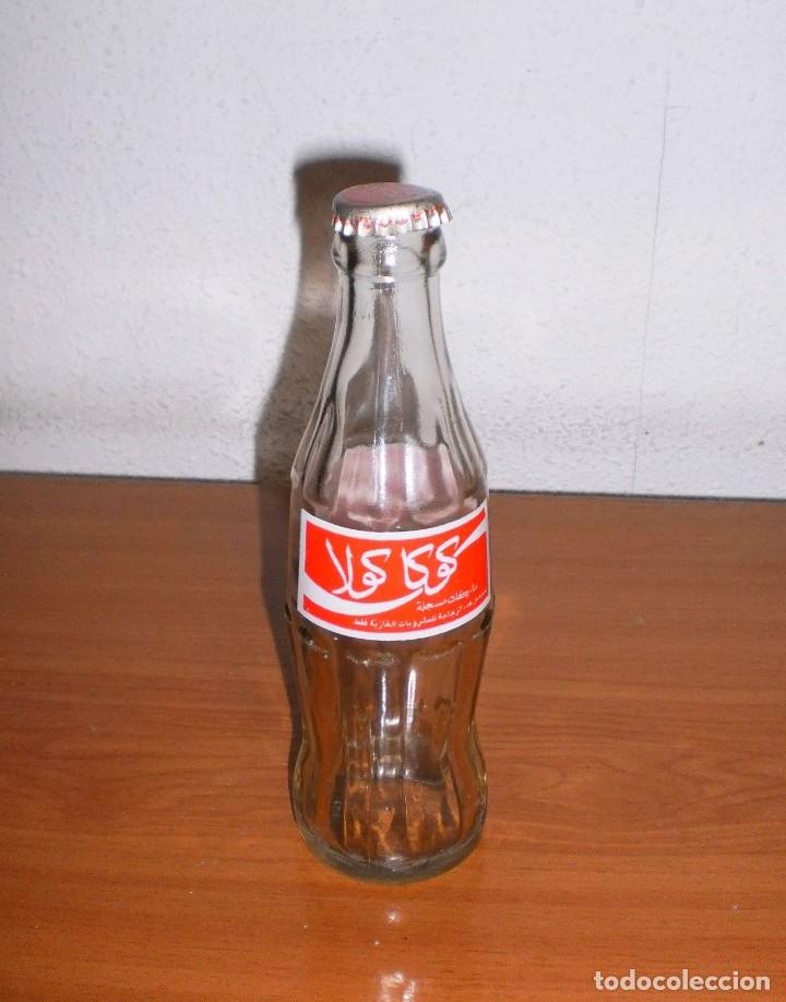 BOTELLA COCA-COLA MARRUECOS VACÍA. ETIQUETA PRENSADA. INCLUYE CHAPA (Coleccionismo - Botellas y Bebidas - Coca-Cola y Pepsi)