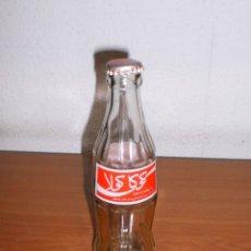 Coleccionismo de Coca-Cola y Pepsi: BOTELLA COCA-COLA MARRUECOS VACÍA. ETIQUETA PRENSADA. INCLUYE CHAPA. Lote 155388226