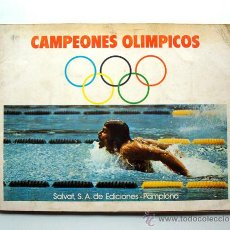 Coleccionismo deportivo: ALBUM 1973 CAMPEONES OLIMPICOS JUEGOS MUNICH 72 ATLETISMO CICLISMO REMO PICTOGRAMAS. FALTA UN CROMO. Lote 70388891