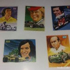 Coleccionismo deportivo: LOTE QUELCOM ASES MUNDIALES 1979, FÓRMULA 1 (FANGIO, FITTPALDI, ICKX, ETC.). 5 CROMOS DIFERENTES. Lote 128726087