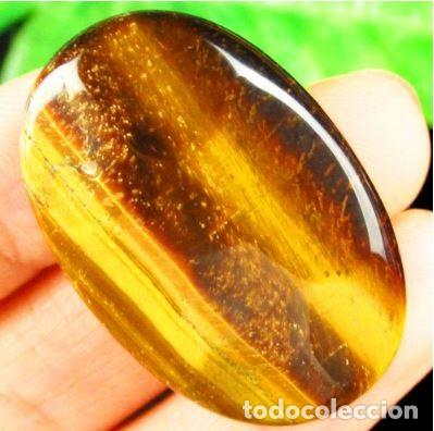 CABUJÓN DE OJO DE TIGRE FACETEADO A DOS CARAS DE MADAGASCAR. MARRÓN-ORO CON 75.5 CT. (Coleccionismo - Mineralogía - Gemas)