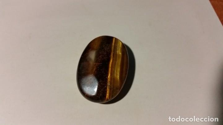 Coleccionismo de gemas: Cabujón de Ojo de Tigre Faceteado a Dos Caras de Madagascar. Marrón-Oro con 75.5 Ct. - Foto 7 - 222172220