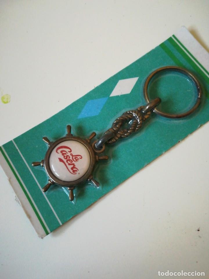 Coleccionismo de llaveros: Llavero con forma de timón La Casera. Nuevo, embalado - Foto 2 - 174170377