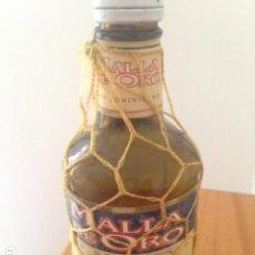 Coleccionismo Otros Botellas y Bebidas: BOTELLA DE RON BERMÚDEZ MALLA DE ORO. Lote 115482919