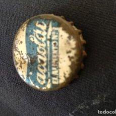 Coleccionismo Otros Botellas y Bebidas: TAPON CORONA. LACTEOS.CACAOLAT. DORSO DE CORCHO. Lote 153871910