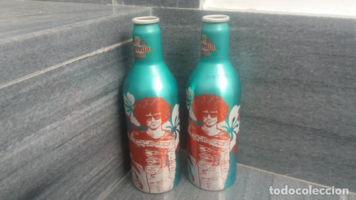 BOTELLAS ALUMINIO DE CERVEZA ESTRELLA DAMM CUSTO BARCELONA CON PEQUEÑA DIFERENCIA DE COLOR (Coleccionismo - Otras Botellas y Bebidas )