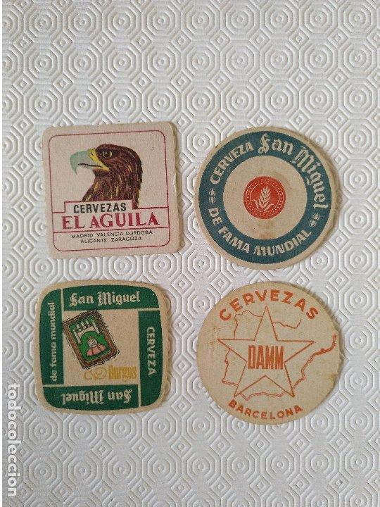 LOTE 4 POSAVASOS. 2 SAN MIGUEL 1 DAMM Y 1 EL AGUILA. USADOS. (Coleccionismo - Otras Botellas y Bebidas )