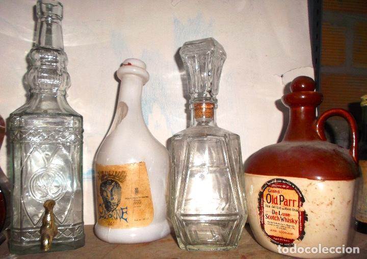 Coleccionismo Otros Botellas y Bebidas: Lote de 8 botellas de colección desde 1890 la verde al 2000 el tarro licorera tallado - Foto 2 - 187502053