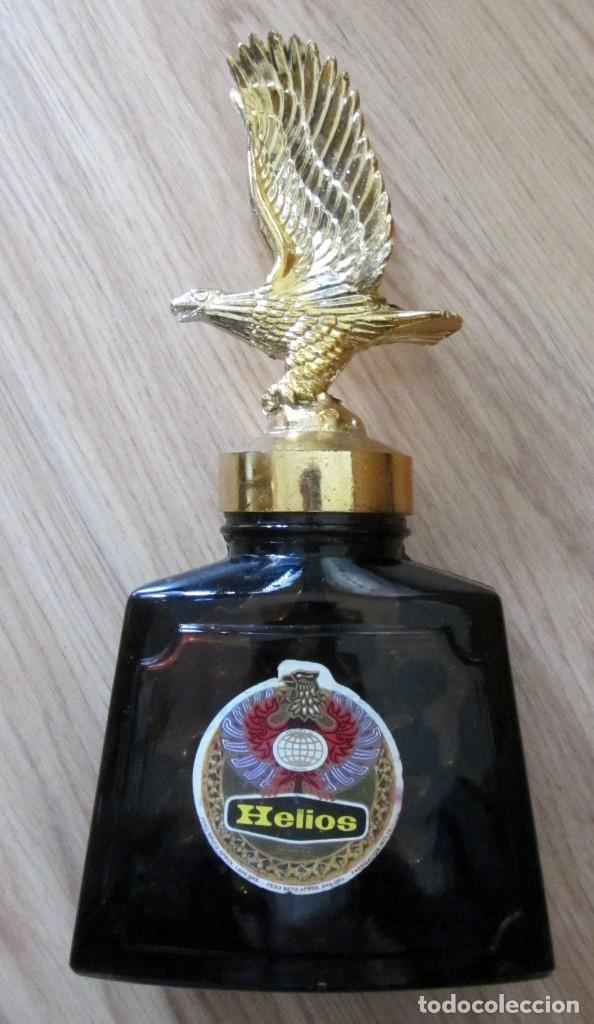 BOTELLA CONSERVAS HELIOS ZARAGOZA AGUILA CLAVERIA PLAZA DEL PILAR LLENA (Coleccionismo - Otras Botellas y Bebidas )