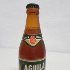 Coleccionismo Otros Botellas y Bebidas: CERVEZA AGUILA DORADA , 33CL , LLENA ,GRABADA EN EL.CUELLO. Lote 253814930