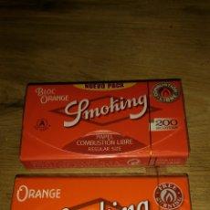 Papel de fumar: DOS LIBRITOS DIFERENTES PAPEL DE FUMAR SMOKING 200 ORANGE. Lote 75997775