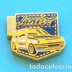 Pins de colección: PIN PEUGEOT 205 JUNIOR. Lote 131076804