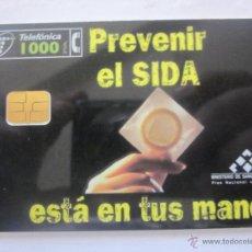 Tarjetas telefónicas de colección: TARJETA TELEFÓNICA ESPAÑA. PREVENIR EL SIDA. TIRADA 853.000. AÑO 1998. Lote 48244555