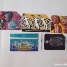 Tarjetas telefónicas de colección: CINCO TARJETAS TELEFONICAS, DIFERENTES, USADAS. . Lote 97948715