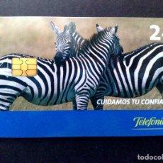 Tarjetas telefónicas de colección: ESPAÑA:TARJETA TELEFONICA-CUIDAMOS TU CONFIANZA,TIRADA 6.500EX.,NOMINAL 2€,AÑO 2005-USADO. Lote 98441615