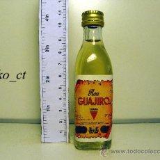 Coleccionismo de vinos y licores: BOTELLITA BOTELLIN RON GUAJIRO COCAL DESTILERIAS COCAL CANARIAS. Lote 38013291