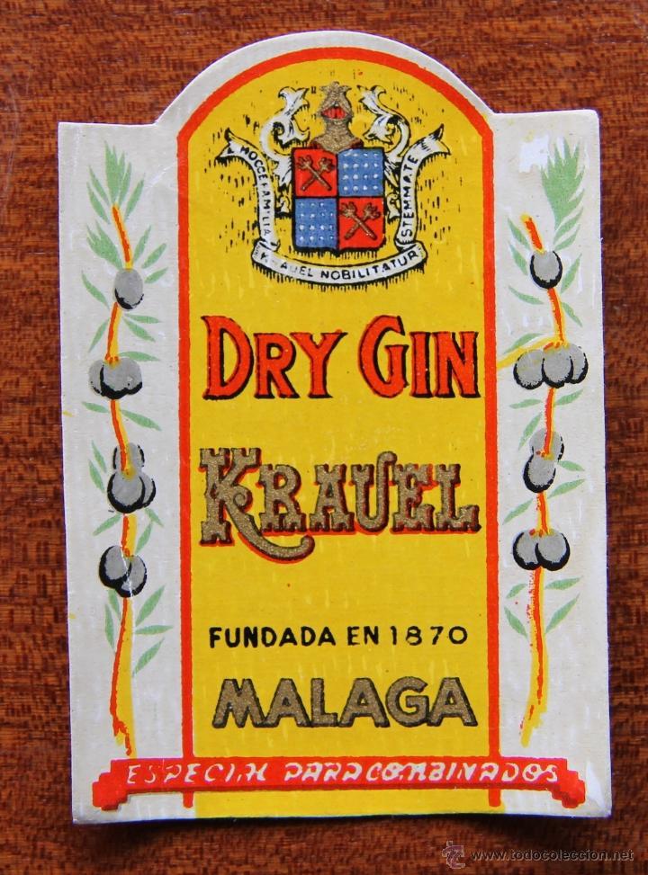 ANTIGUA ETIQUETA DE BOTELLIN DE GINEBRA DE LAS BODEGAS KRAUEL DE MALAGA (Coleccionismo - Botellas y Bebidas - Vinos, Licores y Aguardientes)